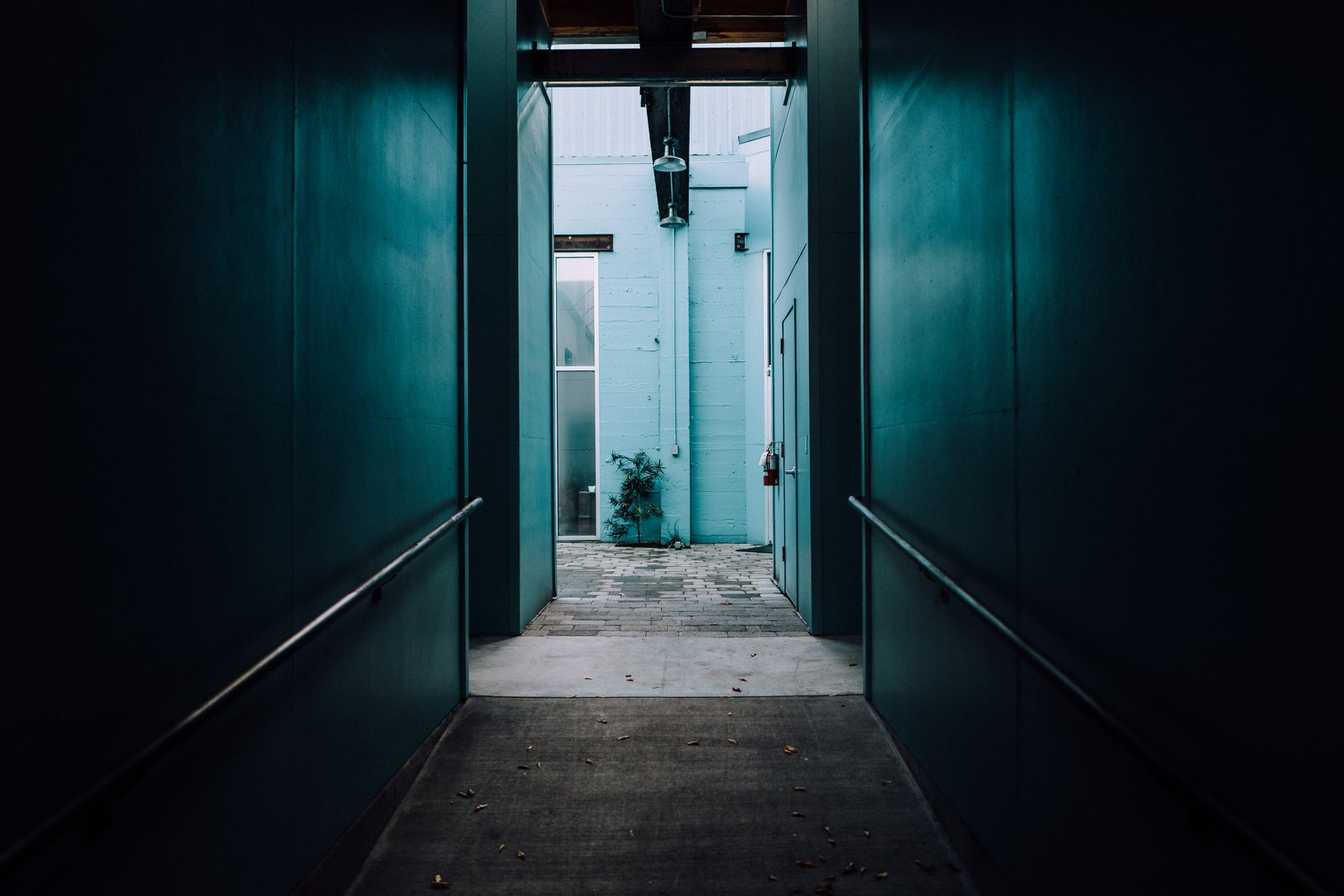 Peering down a dark hallway into cerulean blue green. The Opinionated Leica Q - Photo 6 of 10