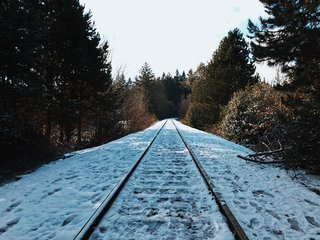 VSCO RAW/X and Topo Designs - Photo 7 of 9 - Icy foot tracks mark this snow-pelted section of railroad track.