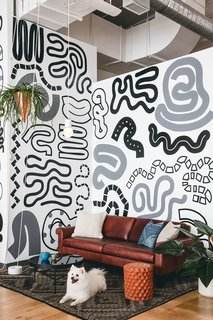 Figma's SF Office Celebrates the Humanity of Work - Photo 5 of 7 - Organic painted patterns create a fun and inviting vibe in this open sitting space.