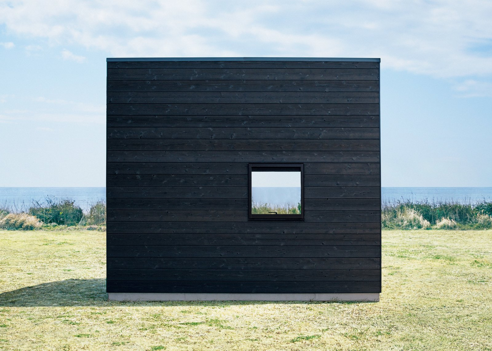 Seeing the hut set against a vast seascape shows how the design allows the structure to be enveloped by the surrounding landscape.  Photo 3 of 7 in The Muji Hut is a Masterful Take on Minimalism