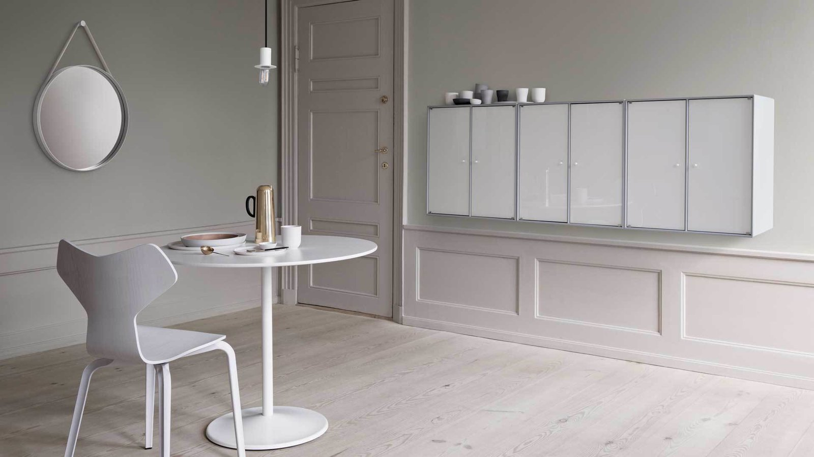 This wall unit mounted in a dining room makes for a subtle way to store dishes and tableware.  Photo 5 of 6 in Denmark's Montana Takes a Modern Approach to Household Storage