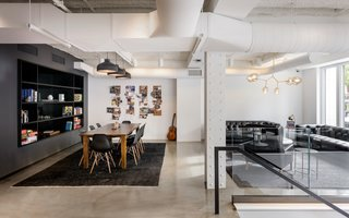 Dwell's Top 10 Offices of 2017 - Photo 2 of 10 - Squarespace is known for its bold and iconic brand, and for helping the masses build sleek, professional websites. Like the restrained, minimalist vibe that their brand conveys, the company's office spaces are equally stark and striking.
