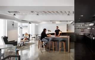 Step Inside Squarespace's Minimalist Portland Office - Photo 1 of 11 - The large circular open bar and the harsh contrast of black and white make a dramatic, yet engaging, place for coworkers to congregate and connect.