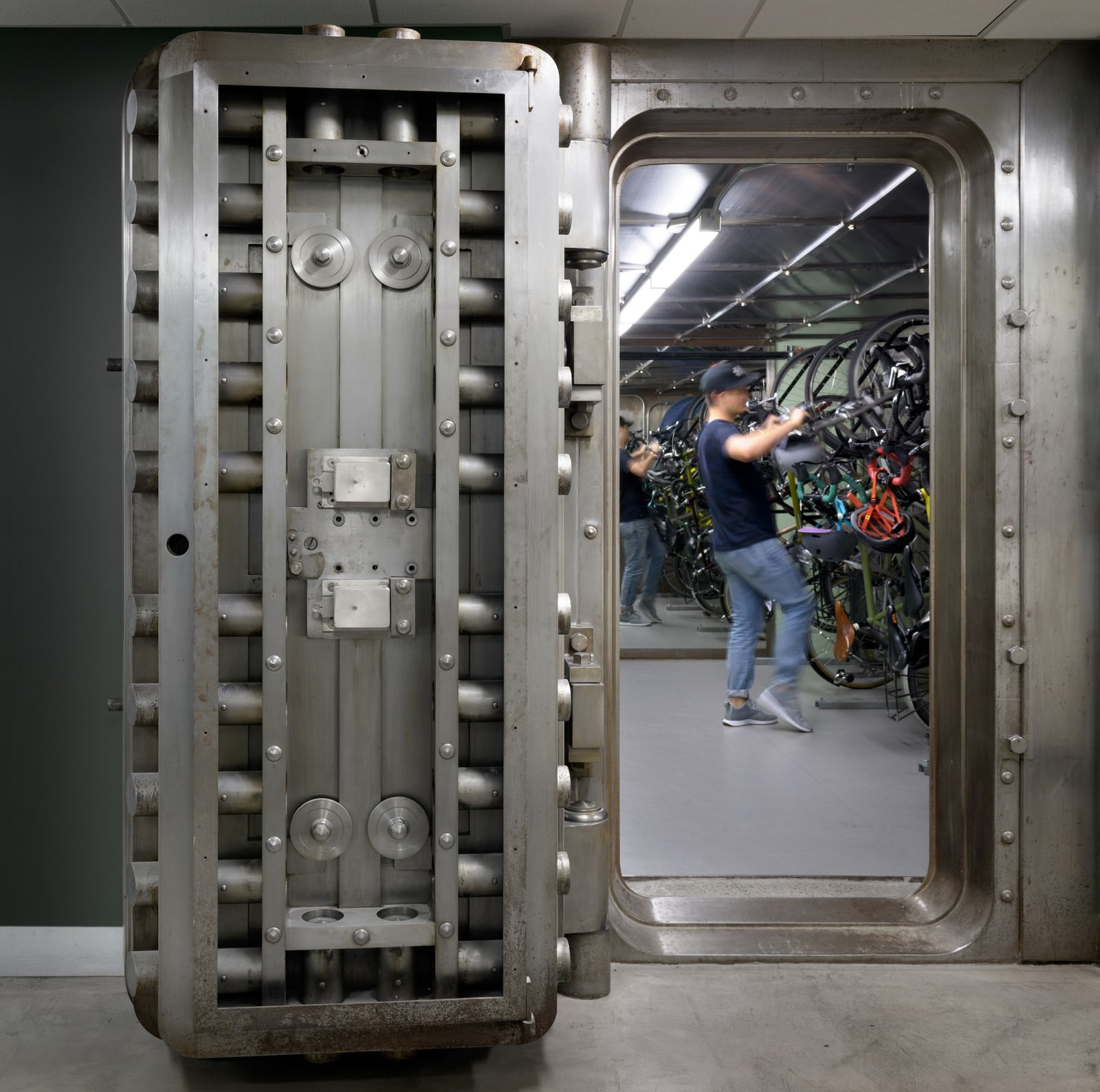 Portland is a bike-friendly city and these massive vault doors create a memorable and secure space for employees to park their vehicles.  Photo 3 of 12 in Step Inside Squarespace's Minimalist Portland Office