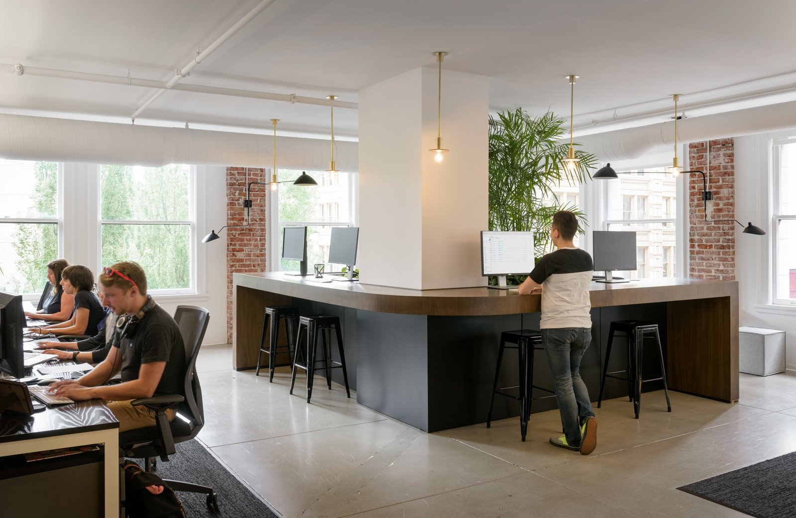 Large standing spaces in common areas is a newer trend in office spaces but allows employees to work in the way that is best suited to them.