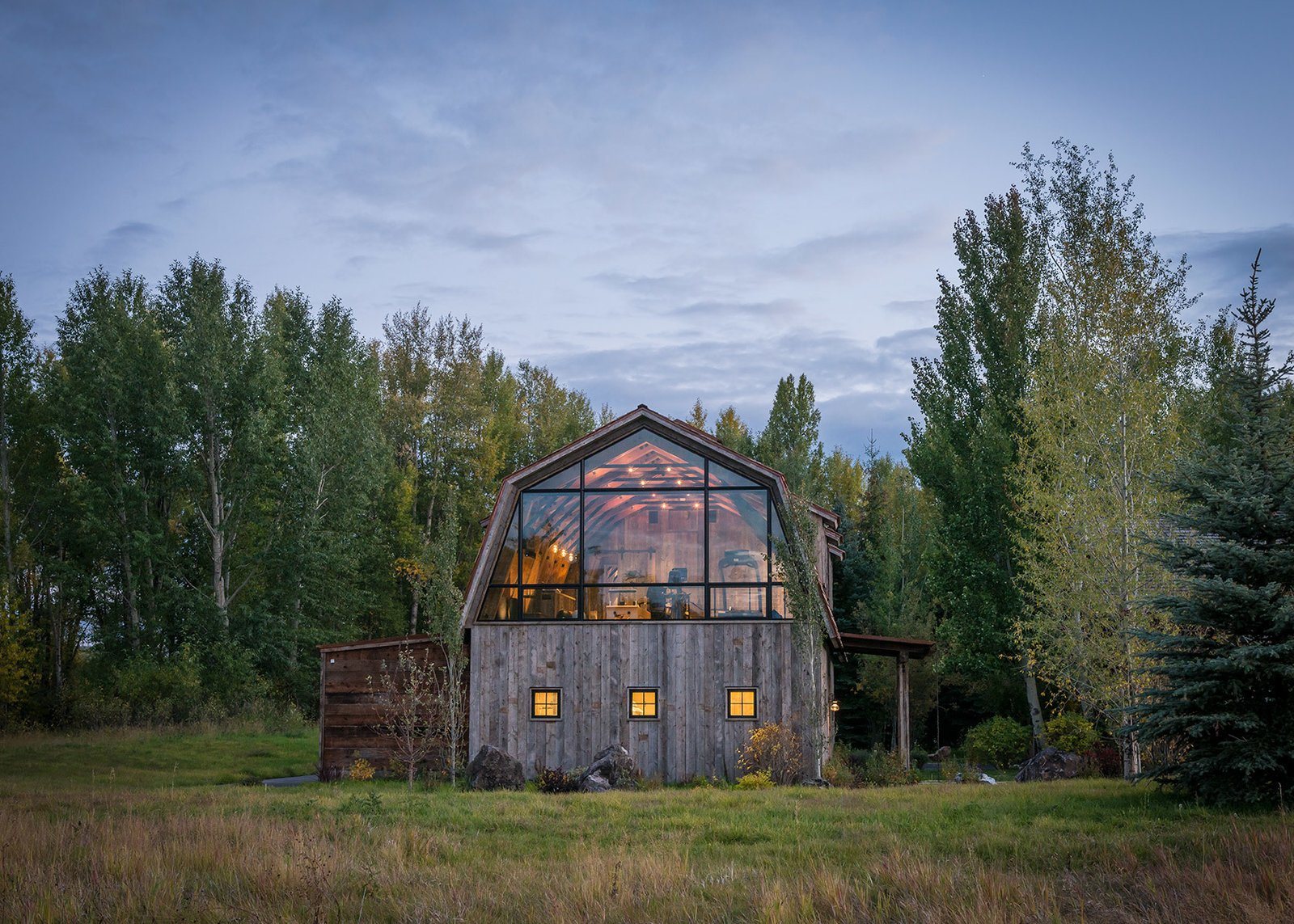 Tagged: Exterior, Gambrel RoofLine, Cabin Building Type, Wood Siding Material, and Shingles Roof Material.  Photo 1 of 8 in A Guest Barn in Jackson, Wyoming, Fuses Modern and Rustic Elements