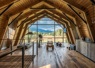 A Guest Barn in Jackson, Wyoming, Fuses Modern and Rustic Elements - Photo 1 of 7 - The extensive use of natural wood on nearly every surface makes the inside of The Barn feel like an extension of the landscape outside.