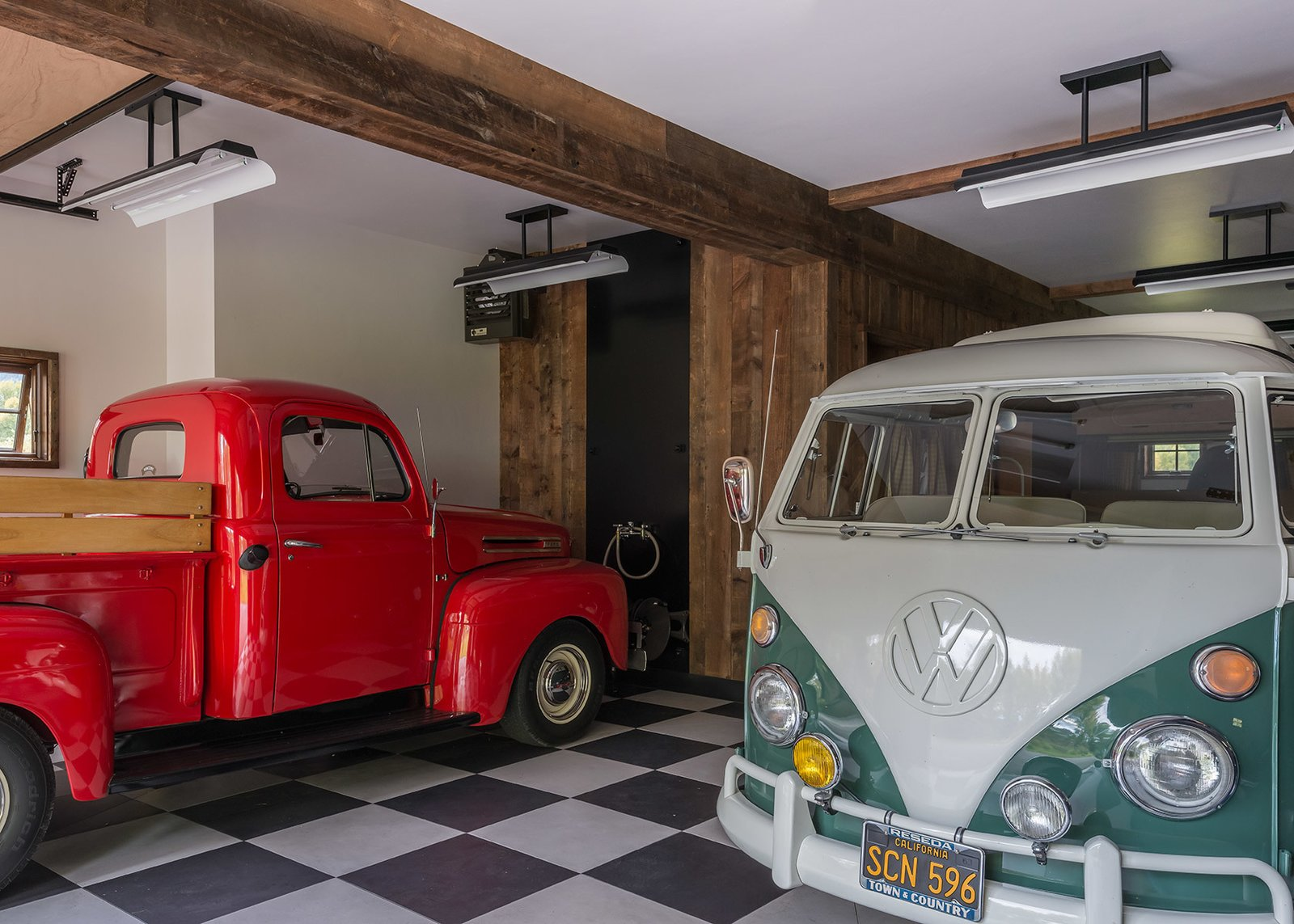 Another view of the garage reveals its extensive space to house vehicles and protect them from the elements.  Photo 6 of 8 in A Guest Barn in Jackson, Wyoming, Fuses Modern and Rustic Elements
