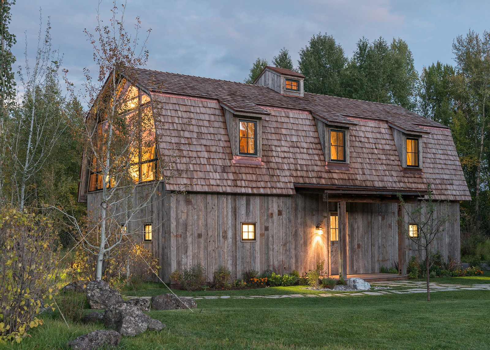 Tagged: Exterior, Cabin Building Type, Gambrel RoofLine, Metal Siding Material, and Shingles Roof Material.  Photo 8 of 8 in A Guest Barn in Jackson, Wyoming, Fuses Modern and Rustic Elements
