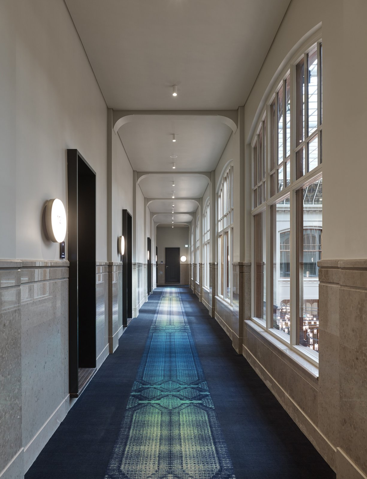 A long view down the corridor of the second floor. Formerly a Historic Bank, This Amsterdam Hotel Honors its Stately Roots - Photo 8 of 14
