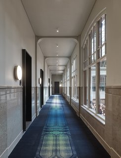 Formerly a Historic Bank, This Amsterdam Hotel Honors its Stately Roots - Photo 8 of 14 - A long view down the corridor of the second floor.