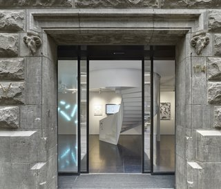 Formerly a Historic Bank, This Amsterdam Hotel Honors its Stately Roots - Photo 10 of 14 - The entrance to X Bank showcases modern works of Dutch art and design which contrast the concrete exterior.