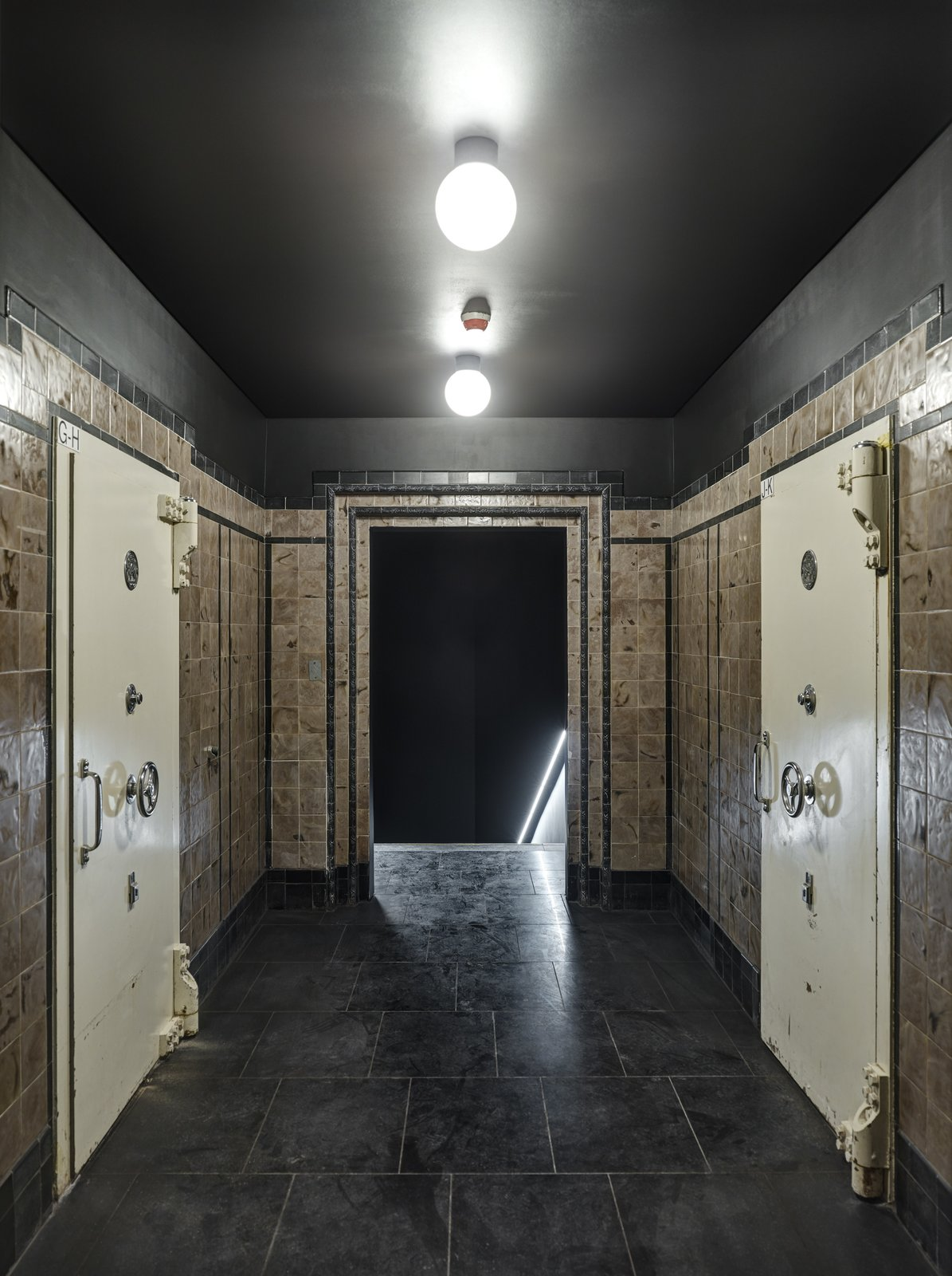 Walking through the bank's old vaults reveals the way visitors can access the spa.  Photo 11 of 14 in Formerly a Historic Bank, This Amsterdam Hotel Honors its Stately Roots