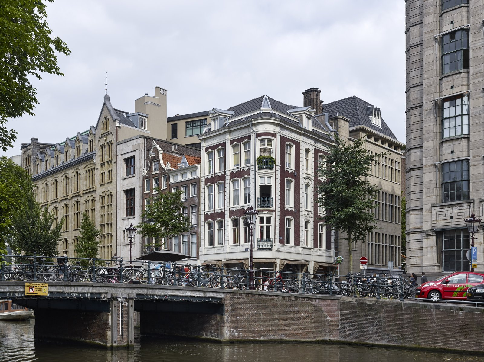 An exterior view highlight's the hotel's façade and how the building seamlessly fits in the surrounding neighborhood.  Photo 14 of 14 in Formerly a Historic Bank, This Amsterdam Hotel Honors its Stately Roots