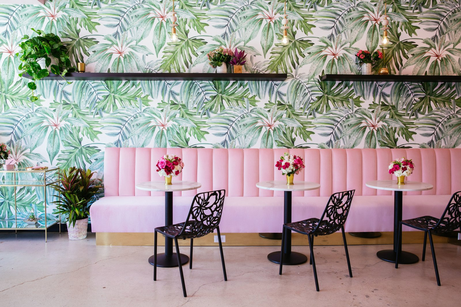 Holy Matcha in San Diego sports wall adorned with bright, floral wallpaper than tranforms the company's retail space.  Photo 10 of 10 in 10 Ways to Use Color to Transform a Room