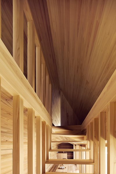 The open staircase is seen from a front angle, showcasing the dynamic lines that converge at the top of the stairway leading to the bedroom space. Photo 9 of Yoshino Cedar House modern home