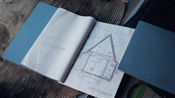 Bound books reveal the angles, measurements, and planned infrastructure for bringing the Yoshino Cedar House to life. Photo 2 of Yoshino Cedar House modern home