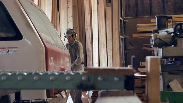 Workers prepare cedar planks for use in Yoshino Cedar House. Photo 5 of Yoshino Cedar House modern home