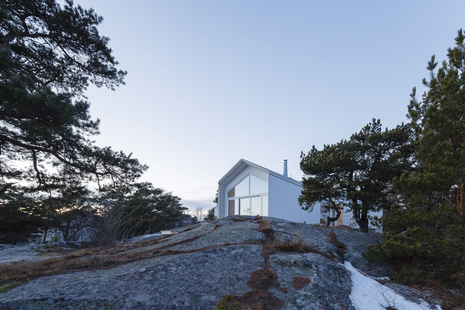 Tagged: Outdoor, Slope, Trees, and Shrubs.  Photo 1 of 12 in A Modern Finnish Villa That Grows Out of a Seaside Cliff