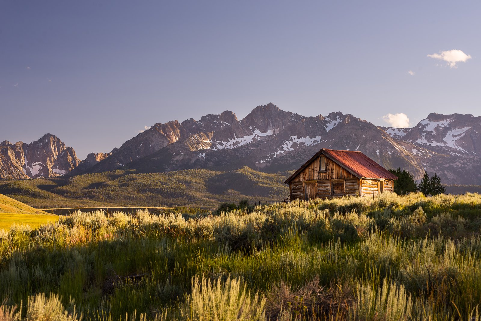 Evening light in the Sawtooth mountains of Idaho. Who wouldn't want to have a cabin here?