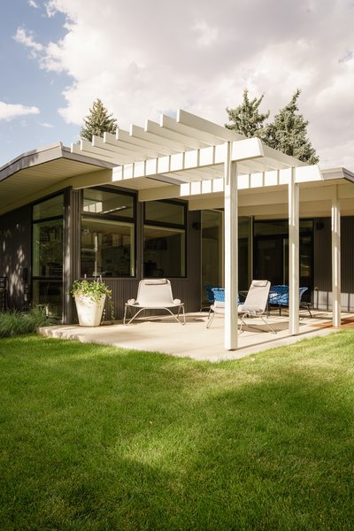 Deep covered rear patio for protecting the house from the western sun in Colorado.  Partial trellis to let some filtered light in. Krisana Park, Denver, CO Cadence Design Studio Photo 7 of Krisana Park Renovation modern home