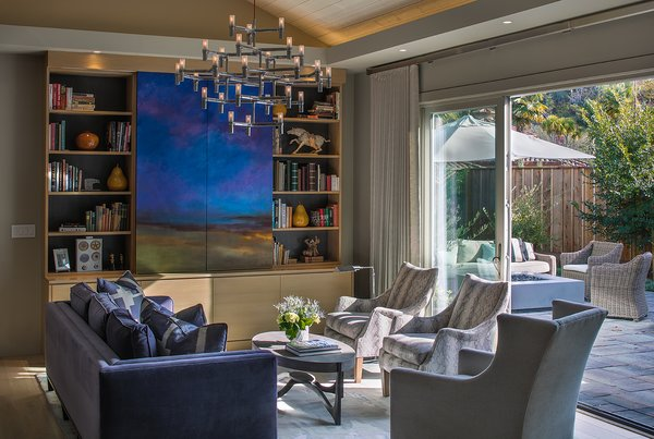 Furnishings provide for a six person conversation group with a wall of glass leading to an inviting outdoor room as large as the indoor space.  Media is hidden behind custom art doors. Photo 2 of A New Beginning modern home
