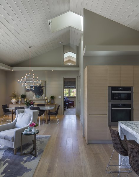 The volume of the great room with its tall ceilings and doors makes the relatively small space feel grand.  A neutral palette, light oak floors and cabinets and dramatic lighting add to the drama. Photo 4 of A New Beginning modern home