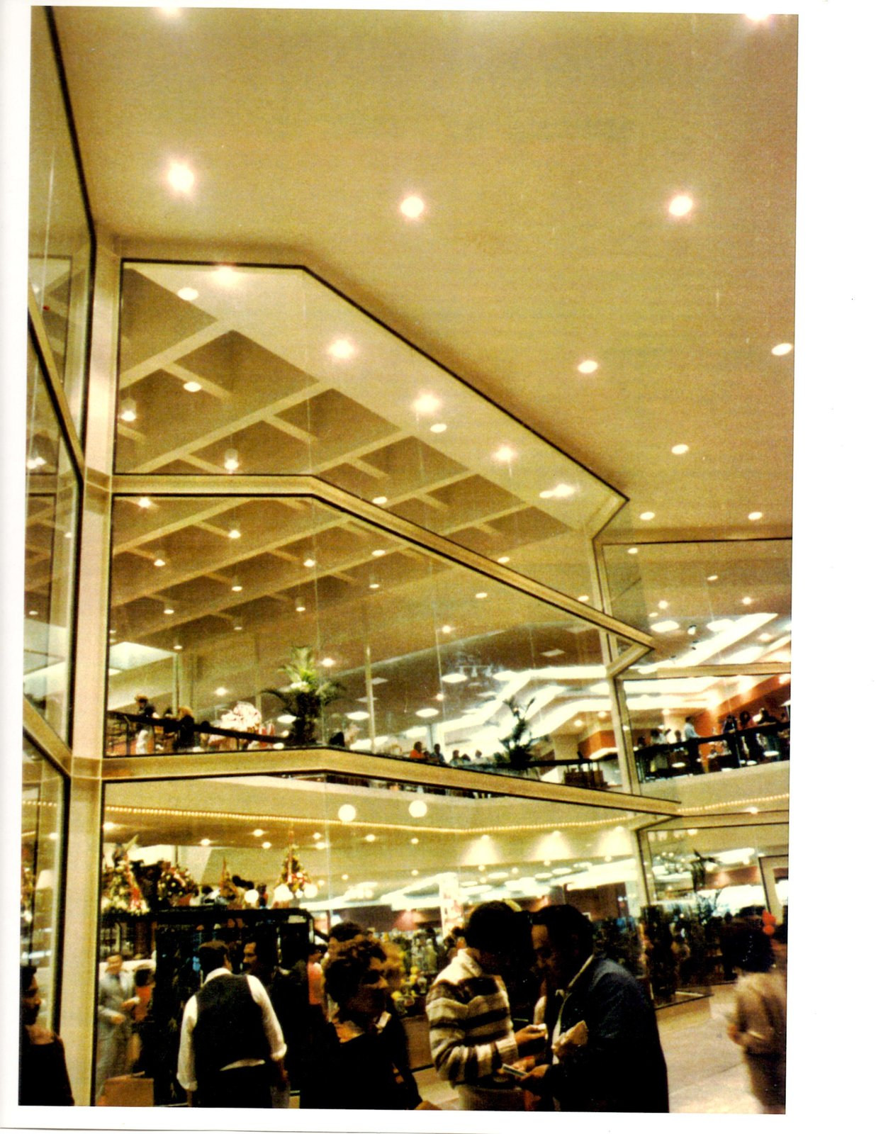 GALLERY PLAZA DEPARTMENT STORE Glass curtain wall served successfully as catalytic between exterior and interior activities at the store.  RETAIL STORES by DM Planning and Architecture Consultants