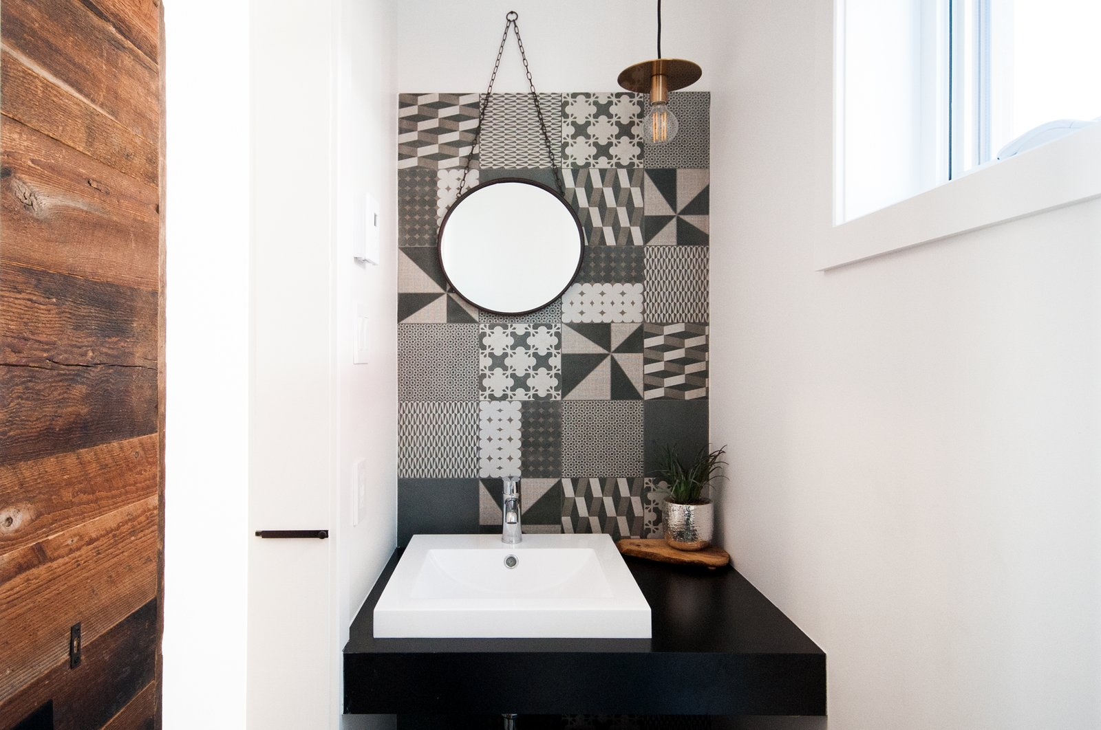 Custom sliding door made with reclaimed wood, tiles by RAMACIERI SOLIGO