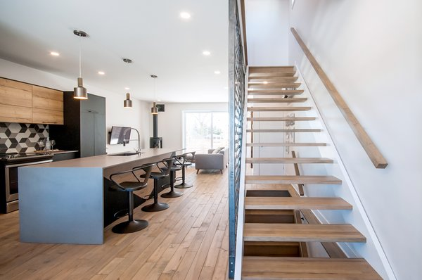 Open concept and good view of the staircase with custom made steel walls Photo 8 of Concept DUB House modern home
