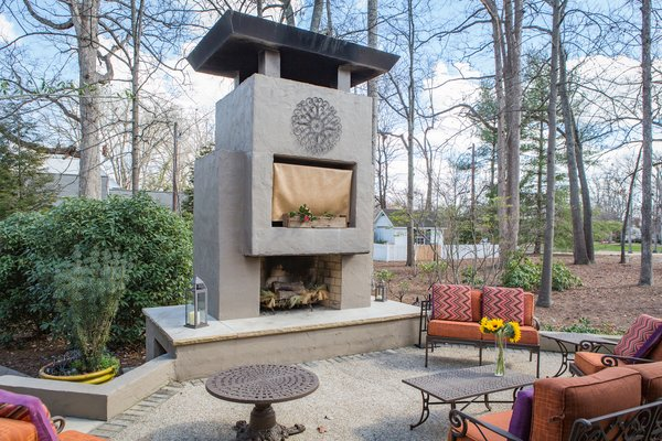 Schechter placed the monumental fireplace to block views of the neighbor's house, thus providing her clients and their guests with a greater sense of privacy. Photo 11 of Mid-century Modern Gathering Space modern home