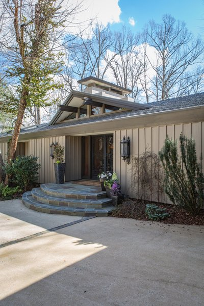 The main entrance. The shape of the chimney cap is a defining architectural feature that Schechter used on her addition as a nod to the original architect. Photo 3 of Mid-century Modern Gathering Space modern home