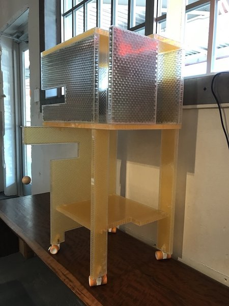 A multi-use Cat Play Tower by Arielle Condoret Schechter, AIA, of Chapel Hill, NC. It doubles as a bar cart. Photo 5 of Designers Create Modern Cat Houses for SAFE Haven for Cats Fundraiser modern home