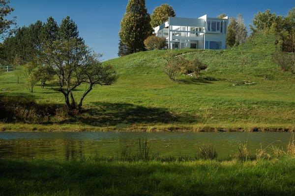 House II / Falk House: View across the pond Photo 8 of House II / Falk House modern home