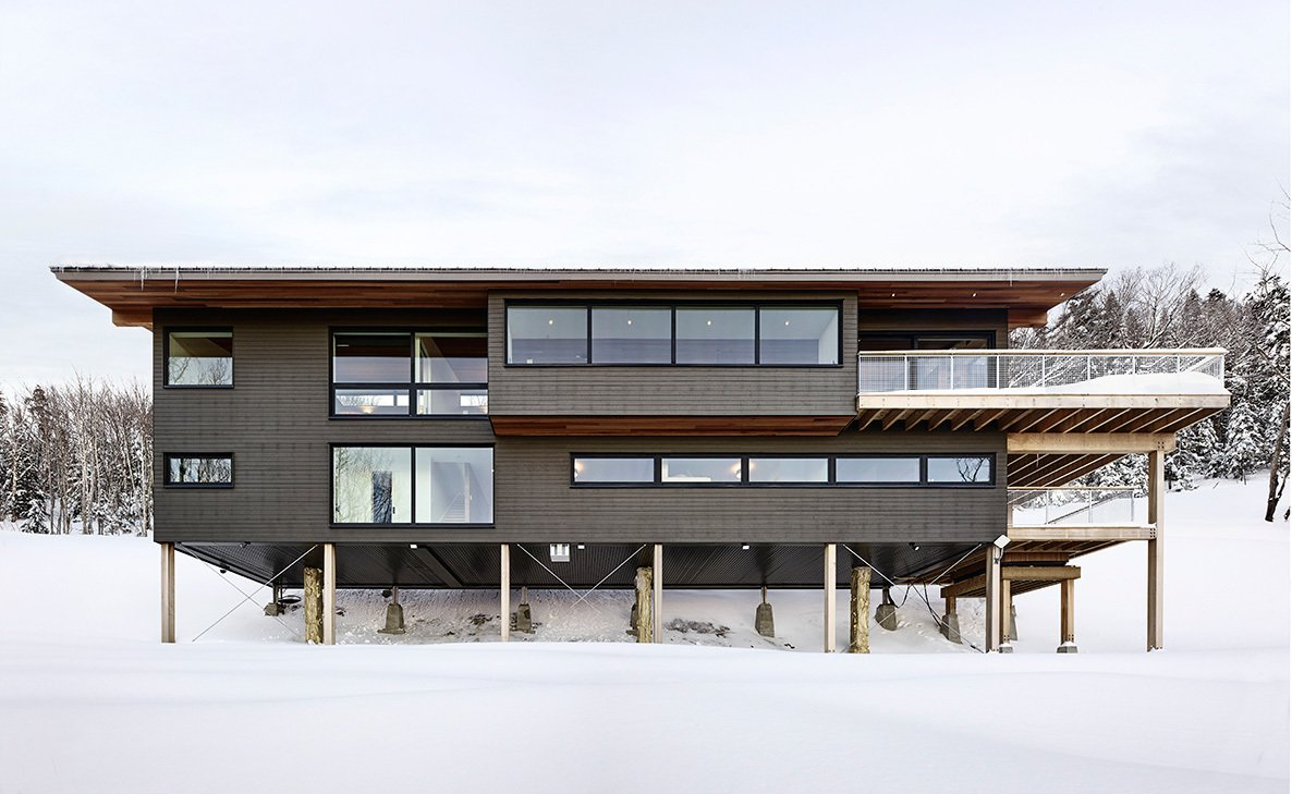 Tagged: Exterior, Wood Siding Material, Metal Roof Material, Cabin Building Type, Shed RoofLine, and House.  Laurentian Ski Chalet by RobitailleCurtis