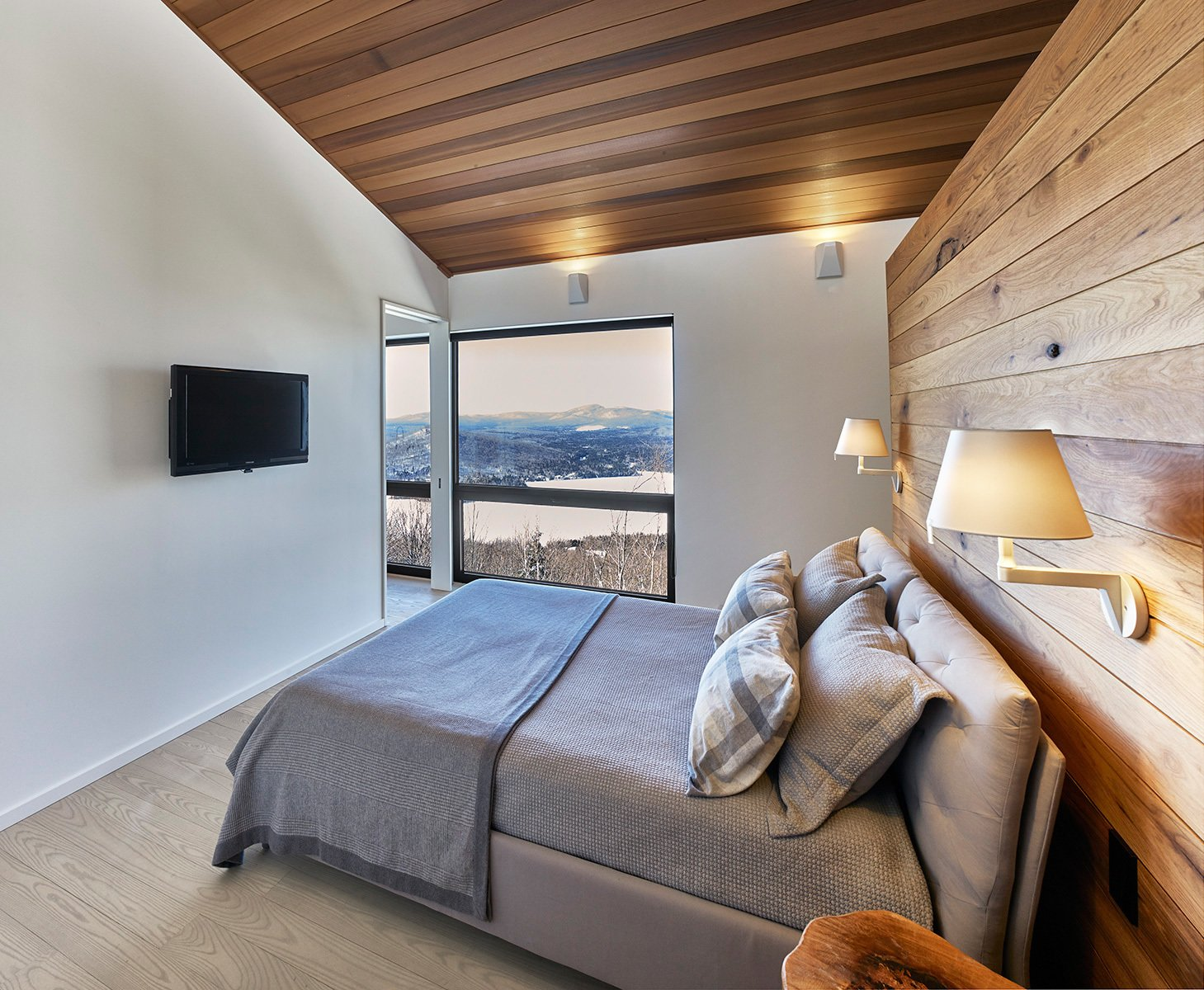 Master Bedroom.  Laurentian Ski Chalet by RobitailleCurtis