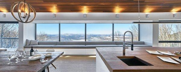 27' Bay window seat. By RobitailleCurtis Photo 8 of Laurentian Ski Chalet modern home