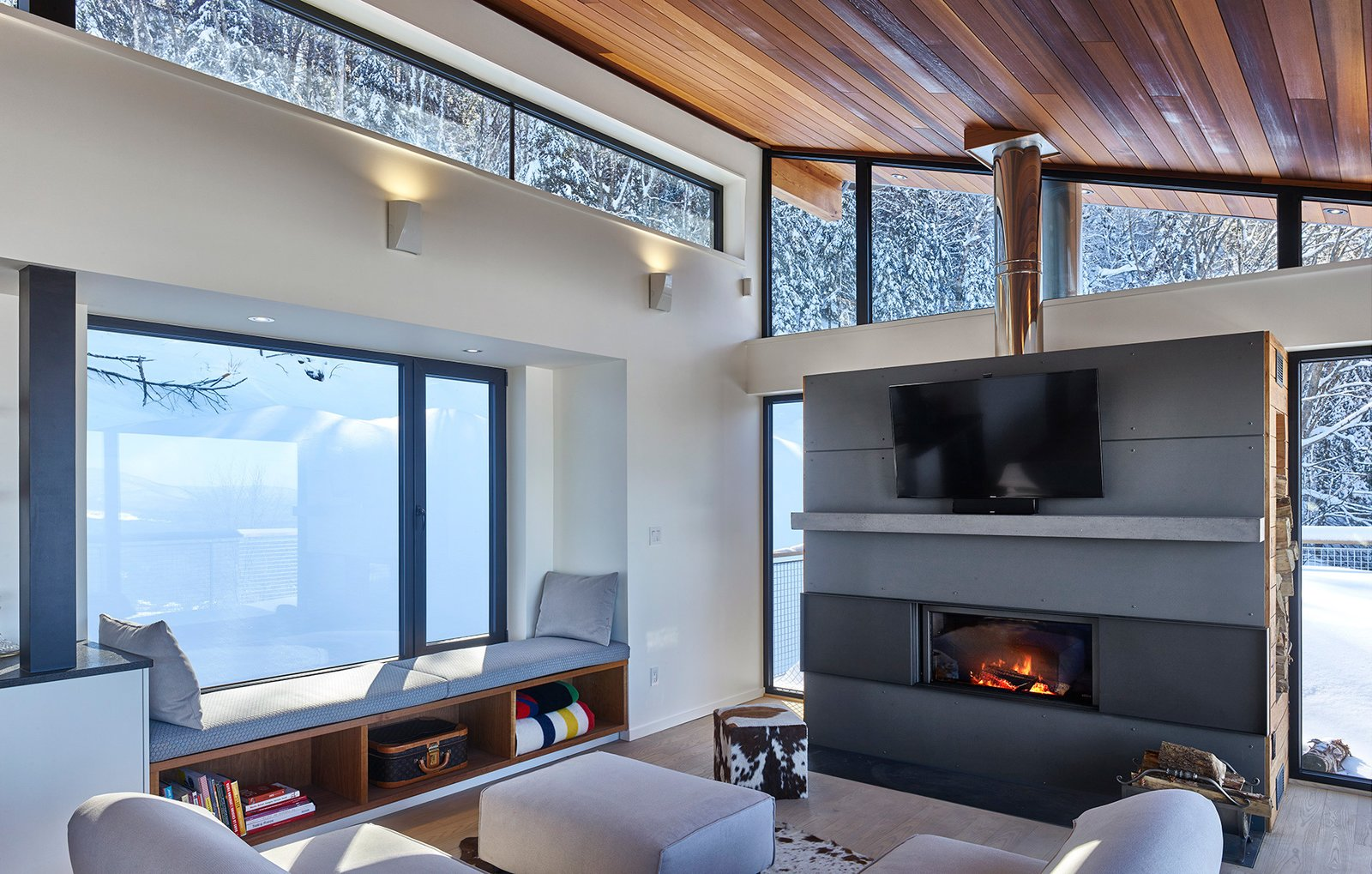 Stuv fireplace and window seat with an up mountain view.  Laurentian Ski Chalet by RobitailleCurtis