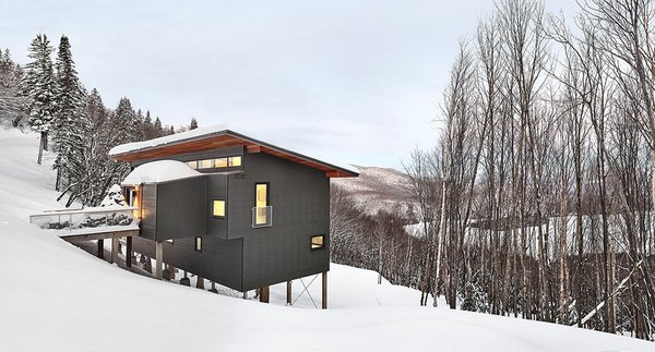 View of chalet from entry drive. By RobitailleCurtis Photo  of Laurentian Ski Chalet modern home