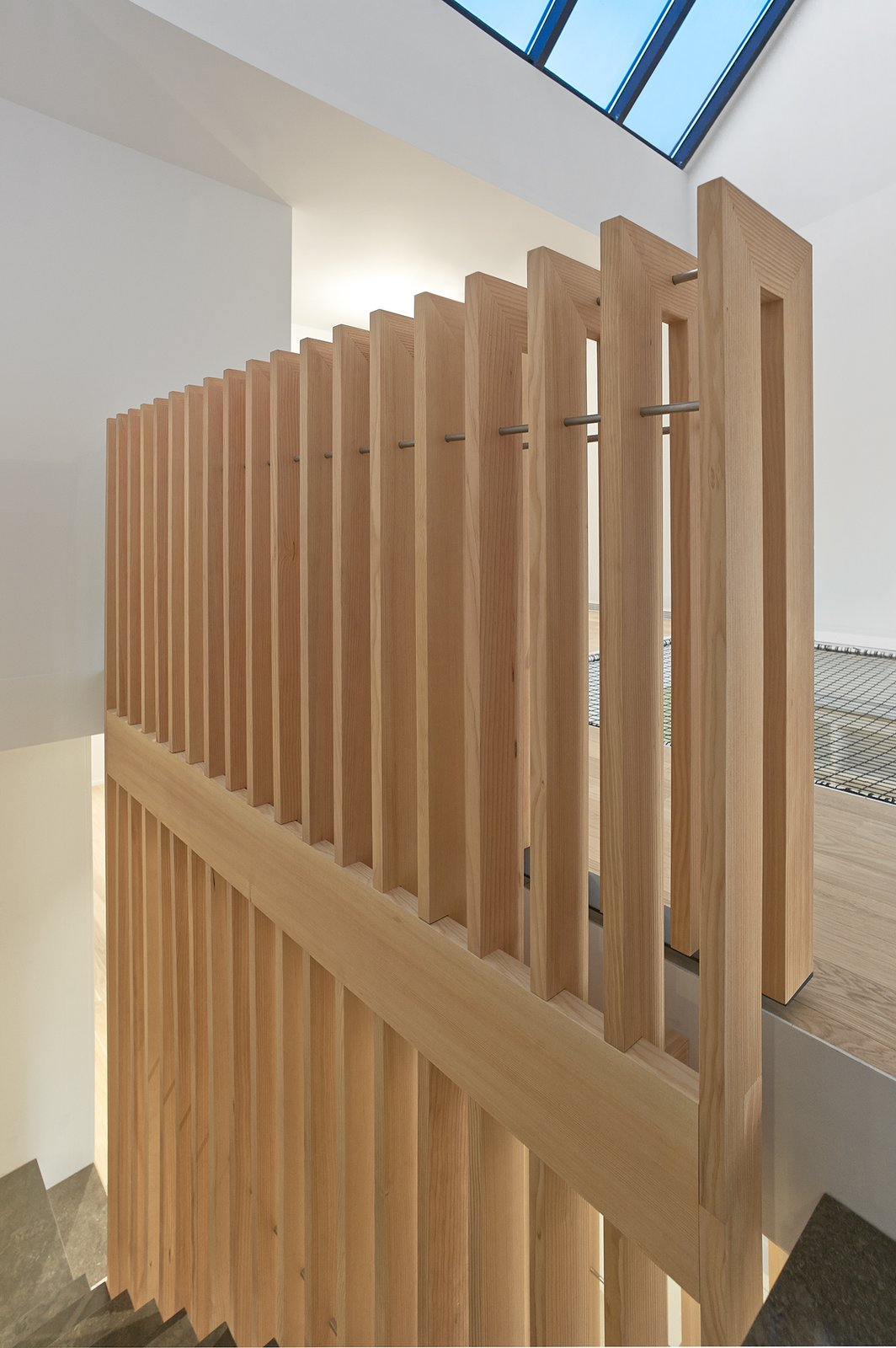 Detail of the douglas fir guardrail at the third floor level.  Atrium Townhome by RobitailleCurtis