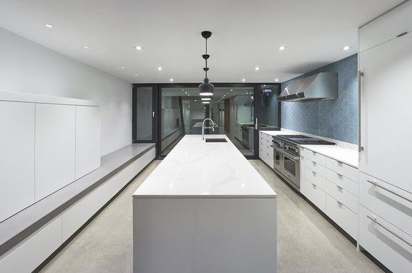 Sleek white kitchen with Heath tile backsplash
