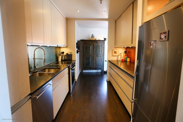 Local Quebec cabinetmaker Richtin built the kitchen custom-designedly Shannon McCardle. Photo 7 of A Penthouse gets reincarnated - from the 19th Century to the 21st modern home
