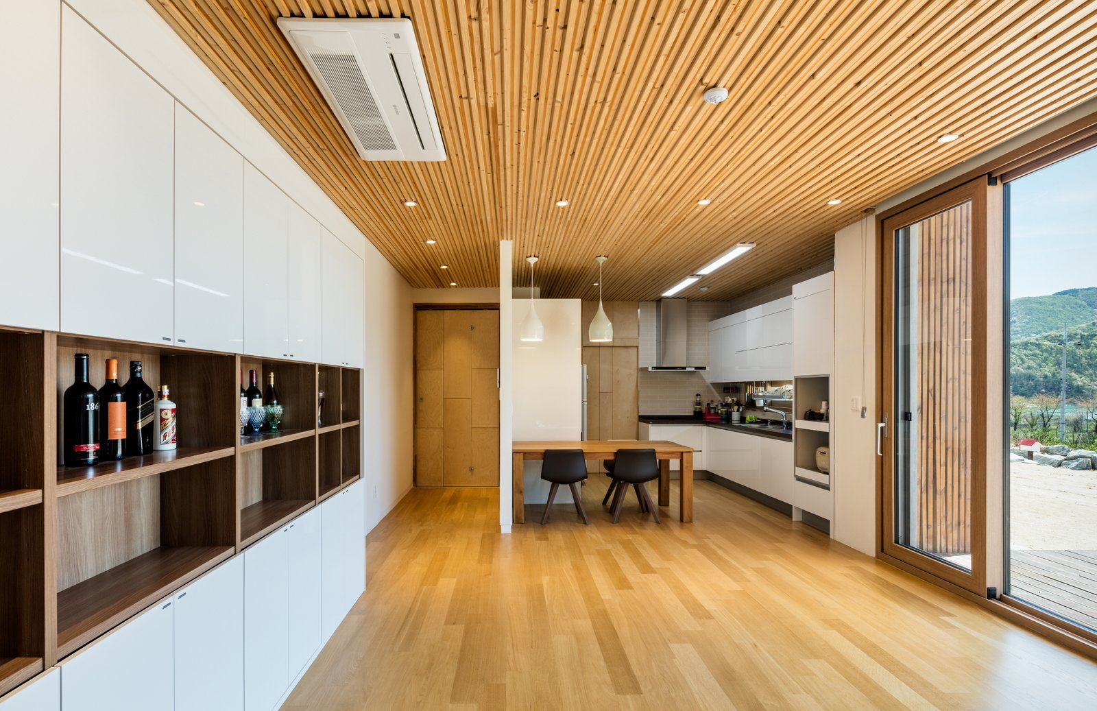 dining & kitchen Tagged: Dining Room, Table, Ceiling Lighting, and Medium Hardwood Floor.  Apple Farm House by 2m2 architects
