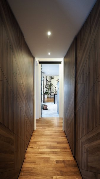 Not having enough space for a full walk-in wardrobe, this corridor in the master bedroom is flanked by full-height wardrobes, making it feel like a regular walk-in wardrobe! Photo 3 of The Singapore Designer Loft: A Fusion of Old and New modern home