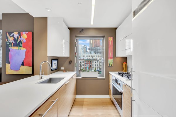 Windowed Kitchen with Custom Bamboo Cabinetry and Recycled Glass Countertops Photo 4 of Now showing for sale: A place to call yours in the city that never sleeps modern home