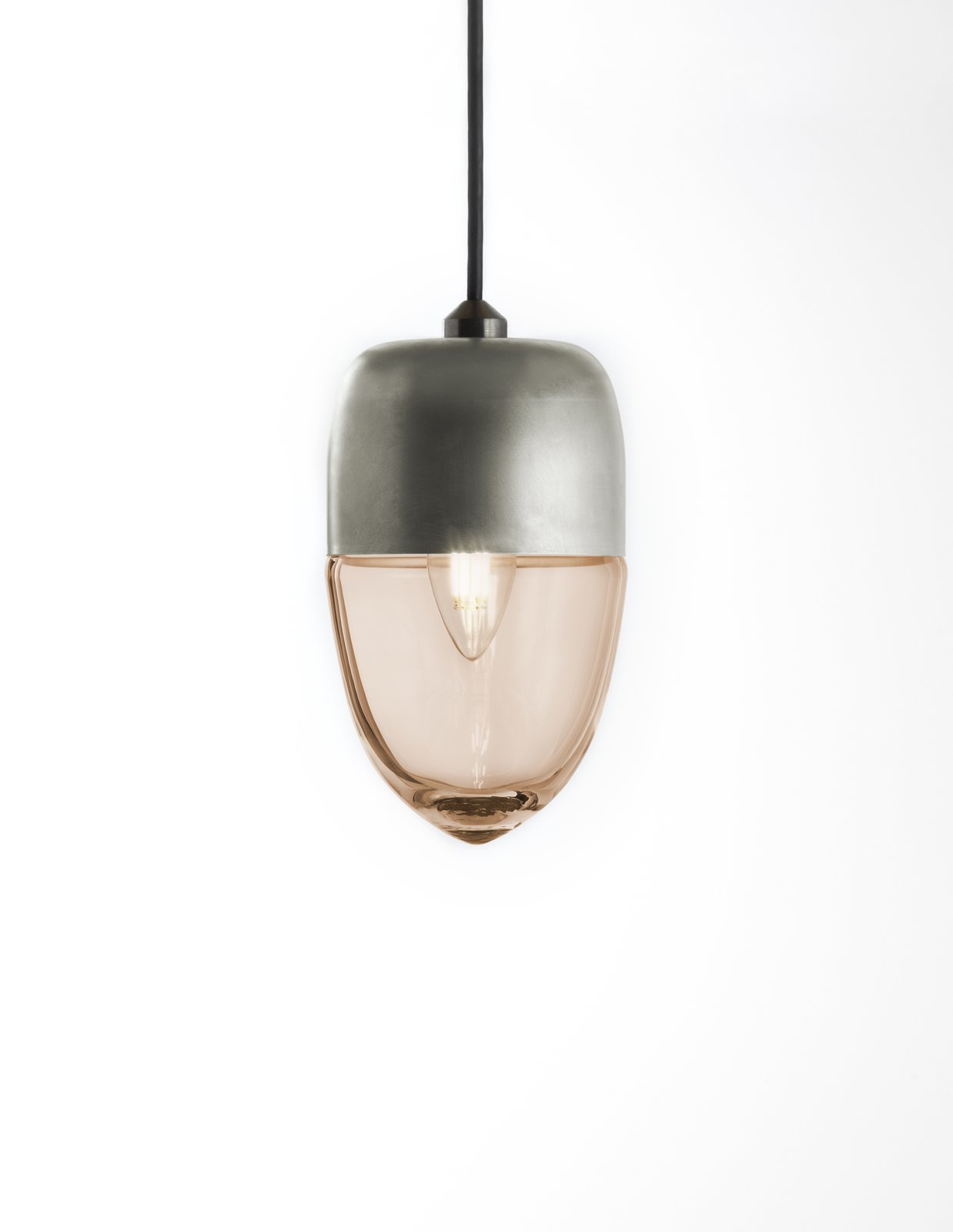 The Vela light has a thin, delicate shape and was designed as small floating vessel for lighting modern spaces. It can be used in multi-pendant installations.