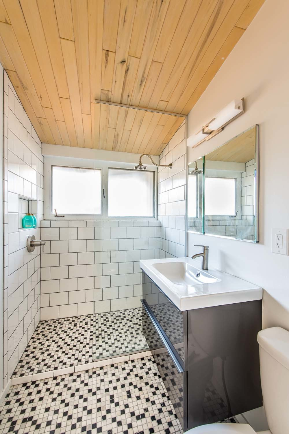 Tagged: Bath Room, Full Shower, and Two Piece Toilet.   from All in the Family