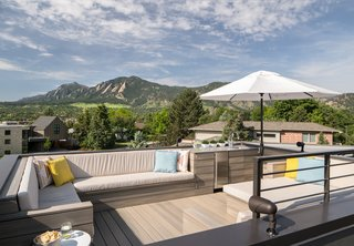 "Inside Out - Photo 6 of 7 - The NewTechWood composite rooftop deck has 360-degree views that include the Front Range and downtown Boulder. ""I call the deck 'the icing on the cake,'"" said the homeowner. The custom furniture was built to be large enough to allow for easy slumber parties (for both adults and kids) under the stars."