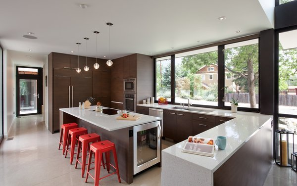 The open kitchen was built by Hammerwell of Boulder, an interior/exterior building firm. The corner lot is set back from the street and doesn't overpower surrounding homes, per strict residential codes and the careful execution of the Arch11 / Hammerwell team.
