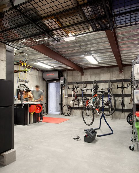 "This room is a far cry from the overcrowded garage the homeowners previously managed. But it was difficult for them to find a house that was just the right size with an oversized garage. ""That was a huge component of why we ended up building a house,"" said the cycling coach who now delights in his private, bike maintenance facility."